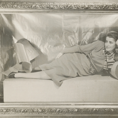 """Aleksander Krzywobłocki, """"Portrait of Mrs. Adler (on the couch)"""", 1932, black-and-white photograph, from the collection of Muzeum Sztuki in Łódź: A black-and-white photograph presents a young woman in a lying pose. The photo is in a decorative frame that closes the composition, which is enriched by numerous dainty mouldings."""