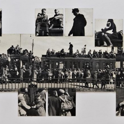 """Jerzy Lewczyński, """"Our Enlargement - Nysa 1945"""", 1971, black-and-white photograph, from the collection of Muzeum Sztuki in Łódź: A black-and-white photograph created with the photomontage technique, which shows a crowded train. The machine at the railway station is surrounded by people who are in the center and the nearby surroundings."""