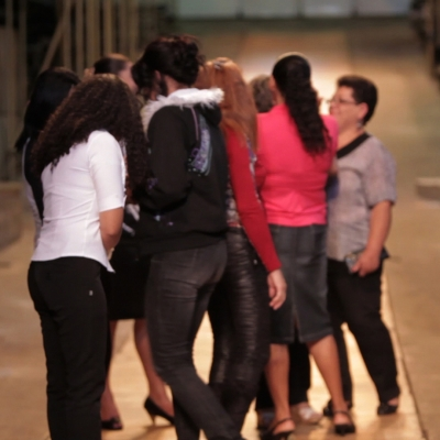 """Wendelien van Oldenborgh, """"Pertinho de Alphaville"""", 2010, installation, digital slide projection with sound, 20 min, courtesy of the artist.: A group of women are hugging and talking to each other."""