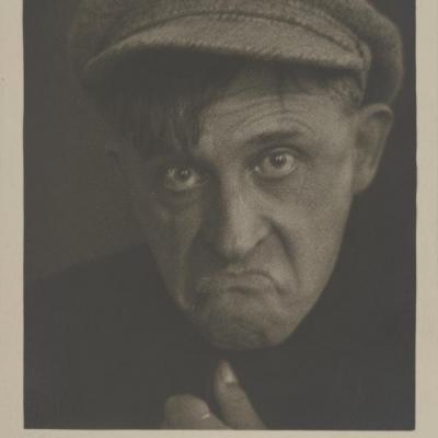 """Jan Głogowski, """"Stanisław Ignacy Witkiewicz"""", ca. 1931, black-and-white photograph, from the collection of Muzeum Sztuki in Łódź: A black-and-white photograph shows a portrait of Stanisław Ignacy Witkiewicz, wearing headwear."""
