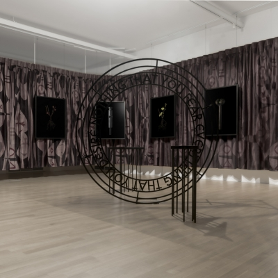 """Jasmina Cibic, """"The Foundation of Endeavour"""", exhibition view, Museum of Contemporary Art Metelkova, photo: Matevž Paternoster, courtesy of the artist: The photo shows the exhibition view. The frame includes a series of 6 reproductions of objects saturated with symbolism. There is an installation in the central part of the reproduction."""