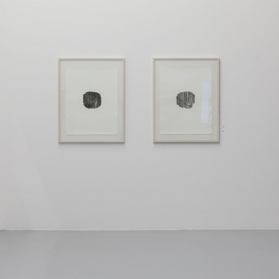 """Céline Condorelli, """"Contact Patch (Register of Collective Labour, Pirelli Factory, Settimo Torinese) I & II"""", 2016, installation view, FRAC Lorraine  (France), photograph by Fred Dott, courtesy of the artist.: The photo contains two artworks created with photopolymer printing on cotton paper. Both artworks are characterized by an achromatic palette and a central composition. A characteristic element of them is the complex structure of the oval shape which is the main element of the work."""