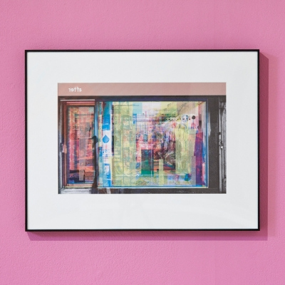 """Céline Condorelli, """"It's All True, Too"""", 2017, installation view, Prologue, Stanley Picker Gallery (Kingston), photograph by Corey Bartle-Sanderson, courtesy of the artist. : The photo shows a multi-color offset print showing the facades of the store. The artwork shows single layers imposed on each other, which make up a whole. The composition is dominated by bright, juicy colors that intertwine. Multi-layering makes the work less readable."""