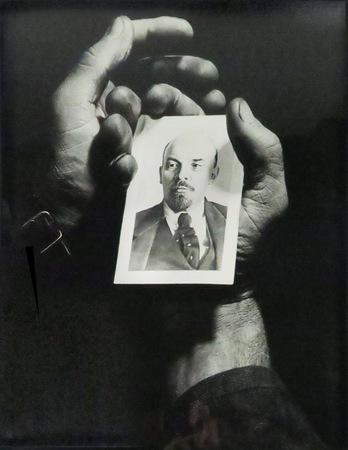 """Anonymous, """"Worker's Hands Holding a Portrait of Lenin"""", c. 1950, b/w photograph, 56 × 43,3 cm, collection of Antoine de Galbert, Paris, photo: Arthur Toqué"""