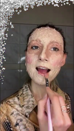 """Brokat Films, a still-frame from the film """"Unistic Composition 8: make-up tutorial, i.e. Face Decor"""" developed during """"Save as Draft"""" residency, 2020"""