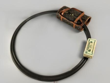 """Javier Téllez (b. 1969), """"Pickpocket's Trainer"""", 2007, electric train set, banknotes, LVMH bag, 20 × 100 × 100 cm, collection of Antoine de Galbert, Paris, photo: Arthur Toqué"""