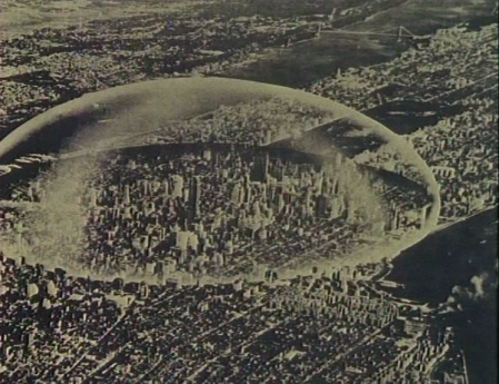 """Superstudio, """"Supersurface: An alternative model for life on the Earth"""", 1972, film, courtesy of Gian Piero Frassinelli: Horizontal sepia shot of a densely built-up city. Bird's eye view. There is a transparent dome around the central part of the metropolis."""